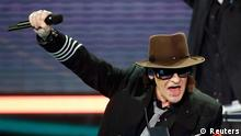 German rock musician and composer Udo Lindenberg holds his trophy at the Echo Music Awards ceremony Berlin March 22, 2012. Established in 1992, the German Phonographic Academy honours national and international artists with the Echo German music prize. REUTERS/Fabrizio Bensch (GERMANY - Tags: ENTERTAINMENT) (ECHO-WINNERS)