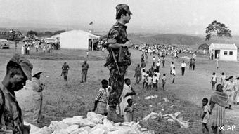 ** FILE ** Portuguese soldiers are on watch at a village near Carmona, in northern Angola, November 14, 1963. A groundbreaking television documentary series currently being aired is confronting Portugal with unsettling aspects of its recent history.(ddp images/AP Photo/don Royle)