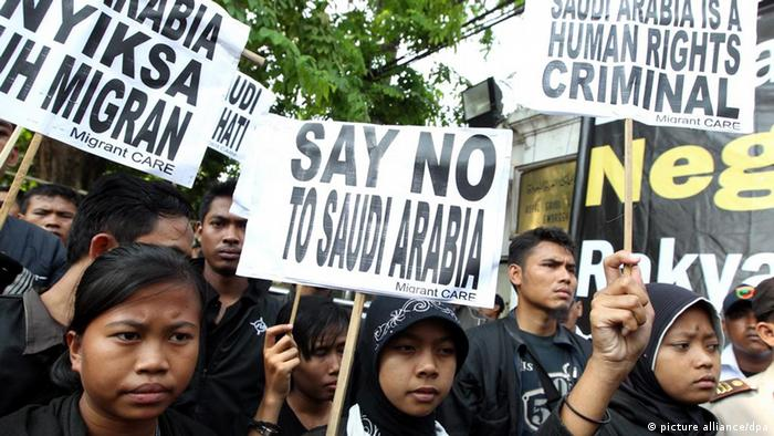 epa02787707 Indonesian migrant worker activists wearing black t-shirts, hold placards during a protest outside the Saudi Arabian embassy in Jakarta, Indonesia, on 21 June 2011. Dozens of activists staged a protest over the beheading of Indonesian domestic worker Ruyati binti Satubi in Saudi Arabia. Saudi authorities executed Ruyati after the supreme court there issued a ruling that confirmed the death penalty for the Indonesian housemaid, who was found guilty of murdering her employee, Khairiya binti Hamid Mijlid, last year. EPA/MAST IRHAM