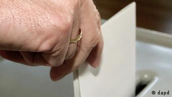 a person casting a ballot