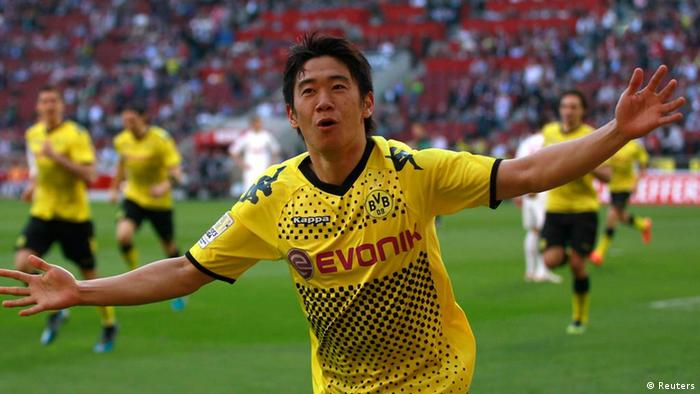 Borussia Dortmund's Shinji Kagawa celebrates a goal against Cologne during the German first division Bundesliga soccer match in Cologne March 25, 2012. REUTERS/Ina Fassbender (GERMANY - Tags: SPORT SOCCER) DFL LIMITS USE OF IMAGES ON THE INTERNET TO 15 PICTURES DURING THE MATCH AND, PROHIBITS MOBILE (MMS) USE DURING AND UP TO 2 HOURS POST MATCH. FOR MORE INFORMATION CONTACT DFL