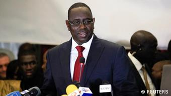 Senegalese opposition presidential candidate Macky Sall speaks at a celebratory news conference in the capital Dakar March 25, 2012. Senegal's long-serving leader Abdoulaye Wade admitted defeat in the presidential election, congratulating his rival Sall, a move seen as bolstering the West African state's democratic credentials in a region fraught with political chaos. REUTERS/Joe Penney (SENEGAL - Tags: POLITICS ELECTIONS PROFILE)