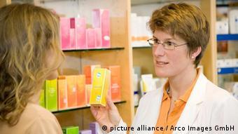 A pharmacist talks with a customer
