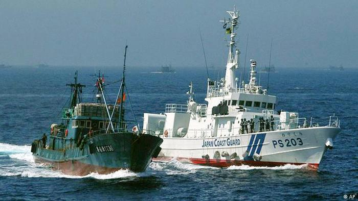 In this photo released by Japan coast guard, its patrol boat Norikura, right, prepares to stop Chinese fishing boat Lurongyu 1736 off Wajima, Ishikawa prefecture, northern Japan, Friday morning, Aug. 5, 2011. Japan has seized two Chinese fishing boats, including Lurongyu 1736, and their captains for alleged illegal fishing off the northern Japanese coast Friday. (AP Photo/Japan coast guard) EDITORIAL USE ONLY