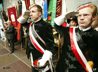 Two men take part in the traditional Sudeten Germans Day in Augsburg