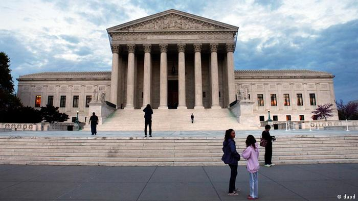People visit the Supreme Court on the eve of the Supreme Court arguments on President Obama's health care legislation, in Washington, on Sunday, March 25, 2012. (AP Photo/Jacquelyn Martin)