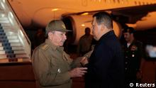 Cuba's President Raul Castro (L) and Venezuela's President Hugo Chavez talk at the Jose Marti airport in Havana March 25, 2012. Chavez flew back to Cuba on Saturday to begin radiation treatment for cancer, but said he was in good shape and would be back home in several days. The socialist leader's latest trip to Havana will heighten anxiety among supporters worried about his health, fan rumors of a power struggle among his top aides, and leave Chavez absent just as his election rival is stepping up a campaign tour. REUTERS/Miraflores Palace/Handout (VENEZUELA - Tags: POLITICS HEALTH) FOR EDITORIAL USE ONLY. NOT FOR SALE FOR MARKETING OR ADVERTISING CAMPAIGNS. THIS IMAGE HAS BEEN SUPPLIED BY A THIRD PARTY. IT IS DISTRIBUTED, EXACTLY AS RECEIVED BY REUTERS, AS A SERVICE TO CLIENTS