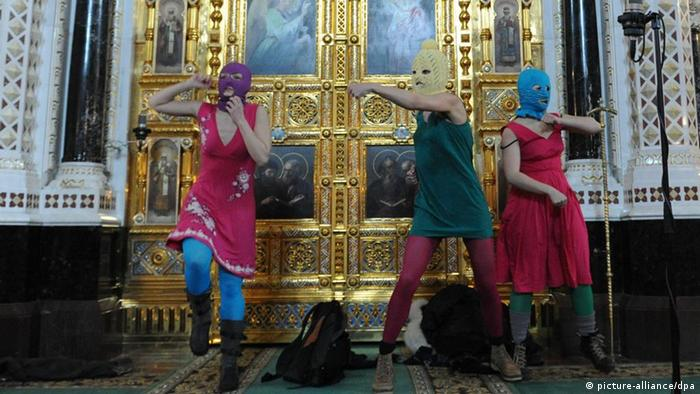 ITAR-TASS: MOSCOW, RUSSIA. FEBRUARY 21, 2012. Masked members of Pussy Riot feminist punk group perform during their 'flashmob'-style protest inside Moscow's Cathedral of Christ the Savior. The girls were marched by guards out of the cathedral. (Photo ITAR-TASS/ Mitya Aleshkovsky)