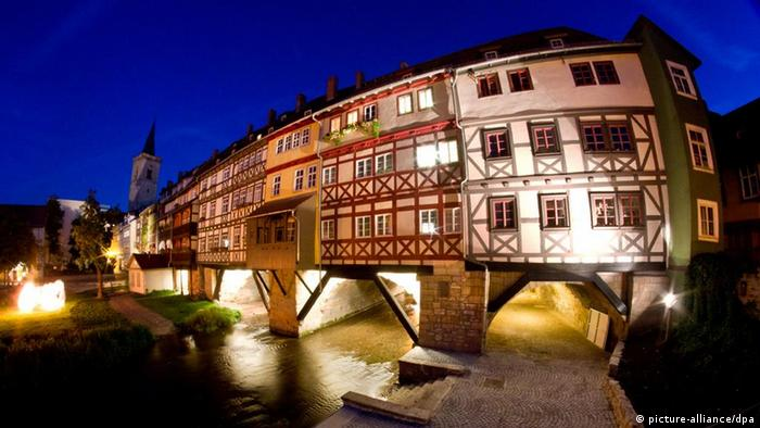 The timber houses atop the Krämerbrücke in Erfurt at night time.