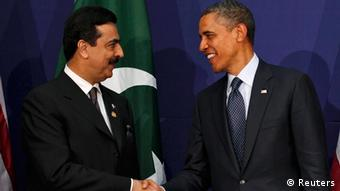 U.S. President Barack Obama (R) shakes hands with Pakistan's Prime Minister Yusuf Raza Gilani during their bilateral meeting on the sidelines of the Nuclear Security Summit in Seoul March 27, 2012.