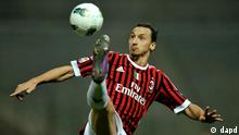 AC Milan's Zlatan Ibrahimovic of Sweden tries an acrobatic shot during their Serie A soccer match against Parma, at Parma's Tardini stadium, Italy, Saturday, March 17, 2012. Milan won 2 - 0 to keep the lead Italian top league. (Foto:Marco Vasini/AP/dapd)