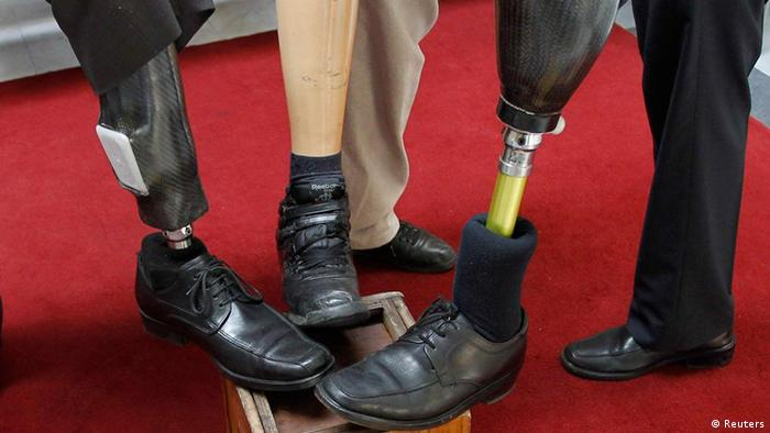 Chilean victims of landmines show their prosthetic legs in support for the global lend your leg campaign