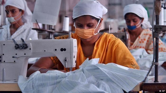Bangladeshi garments workers stitch at a factory in Dhaka, Bangladesh, Thursday, Nov.10, 2005. (Photo: AP)
