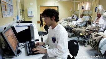 A nurse at a desk in a hospital