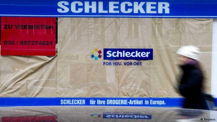 File photo of a woman walking past a former shop of the drug store chain Schlecker in Berlin, January 27, 2012. Germany's biggest drug store chain Schlecker announced on February 29, 2012 to close more than half of its 6000 shops in Germany. The red signs read: To let. REUTERS/Thomas Peter (GERMANY - Tags: BUSINESS EMPLOYMENT)
