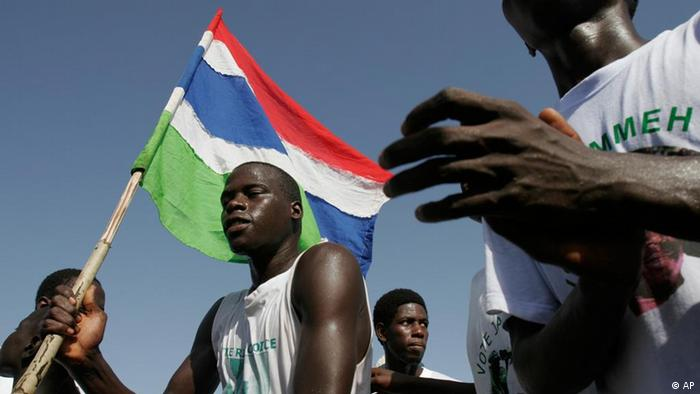 Supporters of President Yaya Jammeh gather on the beach in front of his residence to celebrate his reelection, in Banjul, Gambia Saturday, Sept. 23, 2006. Thousands of people turned out to celebrate Jammeh's election to a third term. (AP Photo/Rebecca Blackwell)