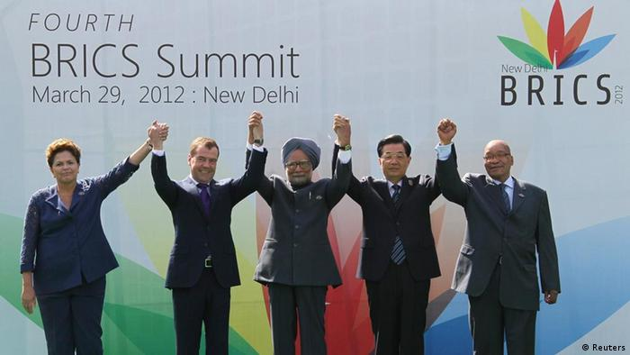 (L-R) Brazil's President Dilma Rousseff, Russian President Dmitry Medvedev, India's Prime Minister Manmohan Singh, Chinese President Hu Jintao and South Africa's President Jacob Zuma pose for a photograph during the BRICS summit in New Delhi March 29, 2012. REUTERS/Yekaterina Shtukina/RIA Novosti/Kremlin (INDIA - Tags: POLITICS) THIS IMAGE HAS BEEN SUPPLIED BY A THIRD PARTY. IT IS DISTRIBUTED, EXACTLY AS RECEIVED BY REUTERS, AS A SERVICE TO CLIENTS