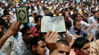 Muslim Brotherhood students hold a copy of the Quran during a protest at the al-Azhar university in Cairo (AP Photo/Hossam Ali)