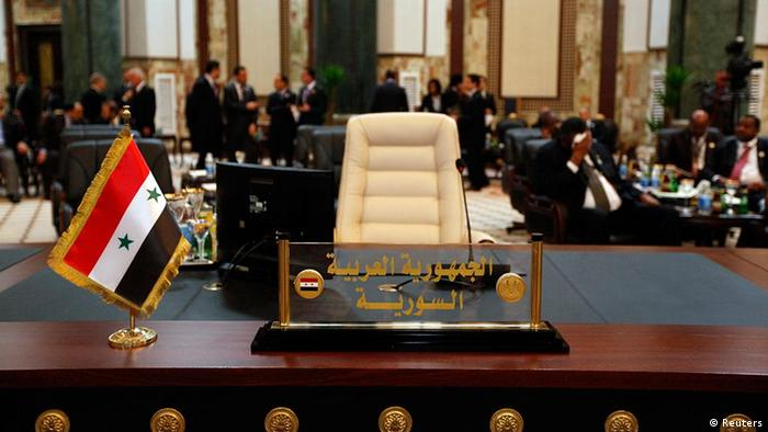 The seat for the Syrian representative is seen empty during the opening session of the Arab League Summit in Baghdad March 29, 2012. REUTERS/Saad Shalash (IRAQ - Tags: POLITICS)