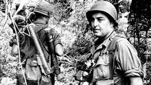 Our undated picture shows Associated Press staff Photographer Horst Faas on assignment in the field with South Vietnamese soldiers. (AP-PHOTOGRAPHER)