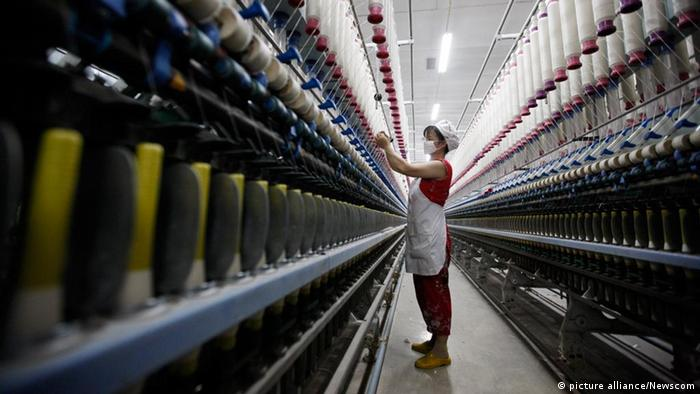 A woman works in a textile factory in Huaibei in central China's Anhui province Wednesday July 13, 2011. China says its Gross Domestic Product expanded by 9.5% in the second quarter, slowed from 9.7% in the first quarter. Photo via Newscom picture alliance