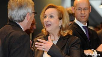 Austria's Minister of Finance Maria Theresia Fekter talking with Luxembourg's Prime Minister Jean-Claude Juncker (left) before the Ecofin Finance Ministers meeting in Copenhagen, March 2012.