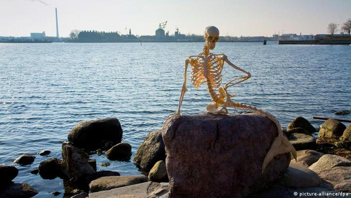 A skeleton mermaid is 01 April 2010 placed on the rock in Copenhagen Harbour, Denmark where the famous statue of fairy storyteller Hans Christian Andersen's figure The Little Mermaid usually is situated. Staff at The State Nationalhistoric Museum are behind this April Fool's Day joke. The museum claims that the skeleton is of the Hydronymphus pesci (waternymph fish), which died out in 15th century. The original statue of The Little Mermaid is presently on its way to China to be exhibited at the upcoming EXPO 2010 Shanghai. EPA/BRIGITTE RUBAEK / HANDOUT DENMARK OUT EDITORIAL USE ONLY/NO SALES