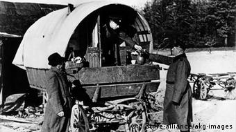 SS members and German police search a so-called Zigeuner camp in Swabia