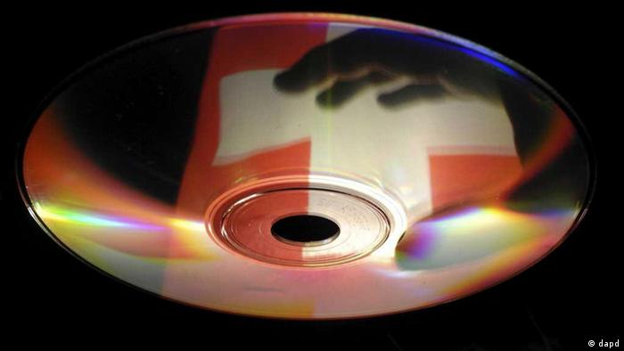 CD with a reflection of the Swiss national flag