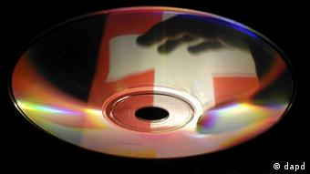 A CD with the reflection of the Swiss flag