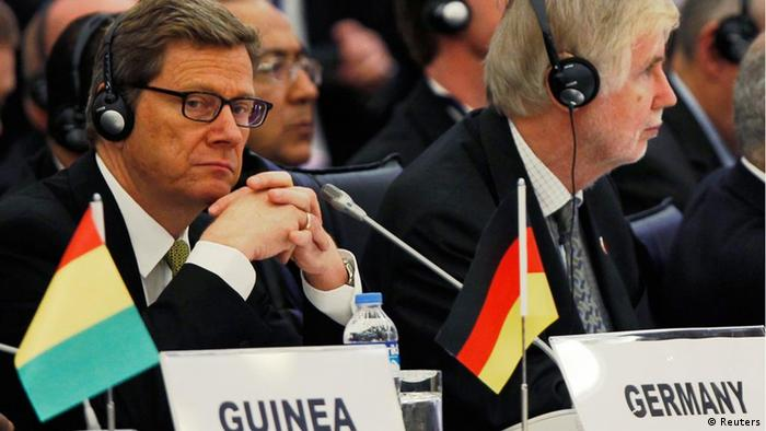 Germany's Foreign Minister Guido Westerwelle (L) attends the opening session of Friends of Syria conference in Istanbul April 1