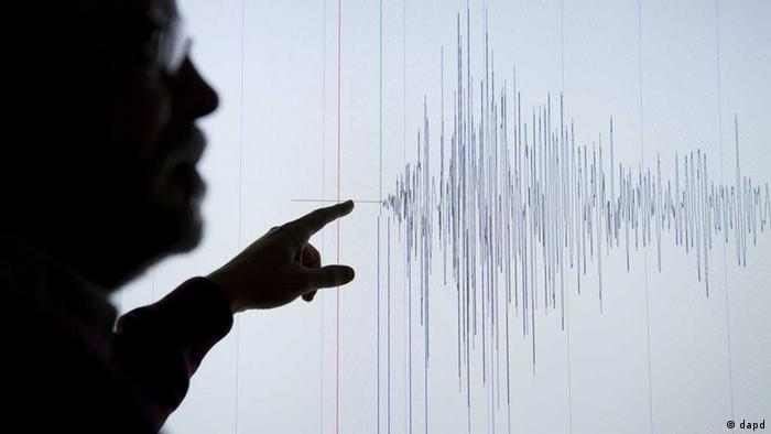 A seismologist points to seismographic waves caused by the Great East Japan Earthquake in March, 2011 (Photo: Klaus-Dietmar Gabbert/dapd)