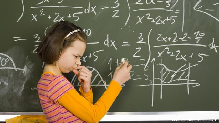 A girl in front of a blackboard
