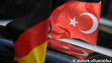 A German and Turkish flag wave in Berlin