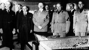German, British, French and Italian heads of state signing the Munich Pact