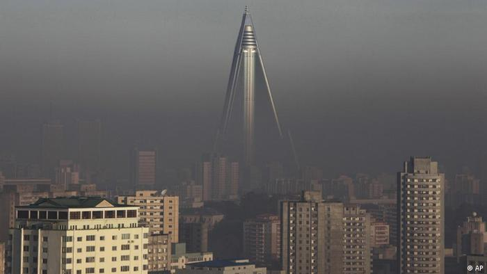 The 105-storey Ryugyong Hotel stands above others in Pyongyang, North Korea. (Photo:Greg Baker/AP/dapd)