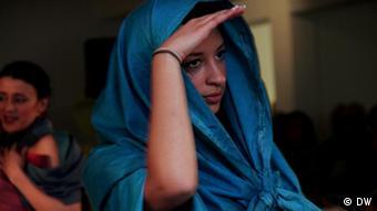 A woman wearing silk woven by Azezana