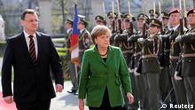 Czech Republic's Prime Minister Petr Necas (L) shakes hands with German Chancellor Angela Merkel at government headquarters in Prague April 3, 2012. REUTERS/David W Cerny (CZECH REPUBLIC - Tags: POLITICS)