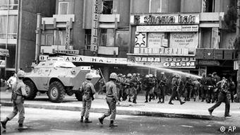 Soldiers disperse demontrators in Ankara streets 300 meters from the parliament few days defore a acoup in this Sept. 1980 photo. The army took over the country to quell leftist-rightist street battles that were killing about a dozen people a day. . (ddp images/AP Photo/Burhan Ozbilici)