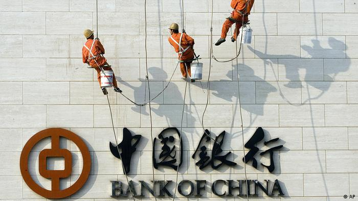 Chinese workers scale the wall near the logo for the Bank of China Ltd., China's second biggest commercial bank in Beijing, China, Monday, Oct. 2, 2006. China's banks have seen revenues soar amid double-digit growth in lending despite government efforts to cool off an economy that expanded by 11.3 percent in the second quarter. Bankers are racing to modernize operations as Beijing prepares to meet a Dec. 11 deadline for fully opening their market to foreign competitors under World Trade Organization commitments.(ddp images/AP Photo/Ng Han Guan)