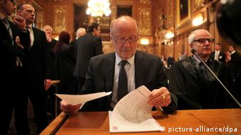 Hesse's transport minister Dieter Posch leaves through documents in the ornate Leipzig courtroom
