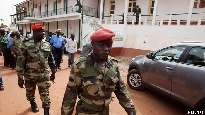 Guinea Bissau's soldiers leave a news conference at the military headquarters in the capital Bissau, March 19, 2012.