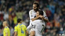 Real Madrid's Cristiano Ronaldo from Portugal, right celebrates with Hamit Altintop of Turkey after Ron aldo scored against Apoel during a second leg, quarterfinal Champions League soccer match at the Santiago Bernabeu stadium in Madrid Wednesday April 4, 2012. AP Photo/Paul White).