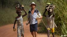 Children living in a cocoa producing village walk back from the fields near Oume, Ivory Coast