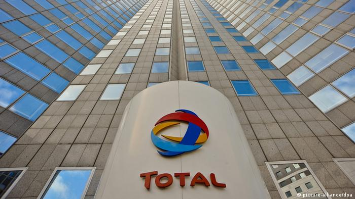 The local of the French oil company Total at the base of a skyscraper, looking up