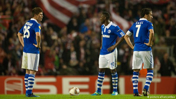 Schalkes Klaas Jan Huntelaar, Chinedu Obasi and Raul (L-R) react after the 1:1 during the UEFA Europa League quarter final second leg soccer match between Athletic Bilbao and FC Schalke 04 at the Estadio San Mamés in Bilbao, Spain, 05 April 2012. Photo: Bernd Thissen dpa