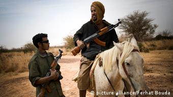 Armed Tuareg rebels with a horse