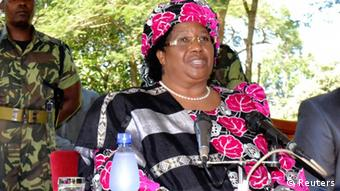 Malawian Vice-President Joyce Banda addresses a media conference in the capital Lilongwe April 7, 2012. Banda took over the running of the southern African nation on Saturday after the death of President Bingu wa Mutharika, and fears of a succession struggle receded as state institutions backed the constitutional handover. The government only officially confirmed 78-year-old Mutharika's death earlier on Saturday, two days after he had died following a heart attack. Seated on either side of Banda are the Inspector General of Police Peter Mukhito (L) and the Army Commander General Henry Odilo. REUTERS/Mabvuto Banda (MALAWI - Tags: POLITICS MILITARY)