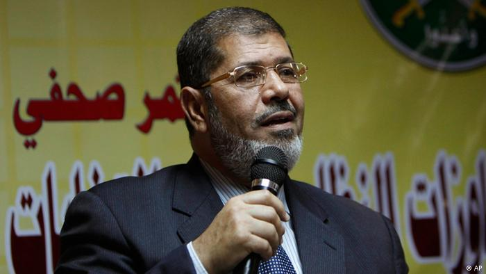Muslim Brotherhood spokesman Mohammed Morsi speaks during a press conference alleging early fraud in Egypt parliamentary elections, at the group's offices in Cairo, Egypt Monday, Nov. 22, 2010. The widespread crackdown on the opposition Muslim Brotherhood as it attempts to campaign for upcoming parliamentary polls means there will be no election in Egypt, said one of the group's lawmakers on Monday. (ddp images/AP Photo/Nasser Nasser)