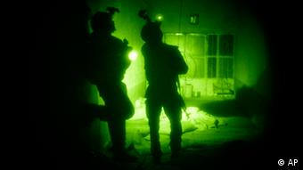 U.S. Special Operations forces search a home during a joint operation with Afghan National Army soldiers targeting insurgents operating in Afghanistan's Farah province. Increased nighttime military raids by international military forces in Afghanistan have created a resentment that has undercut any battlefield gains from the tactic, according to a report released Monday, Sept. 19, 2011, by a U.S. think tank.